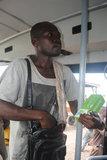 Man selling herbal medicine on a passenger