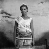 Ever Young Studio 1953-1959 Portrait of woman wearing Kente cloth and a banner that reads Miss Accra at Ever Young Studio.