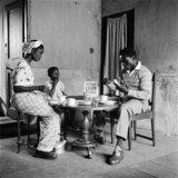 Roy Ankrah having breakfast with his family in  Accra, Ghana 1952.